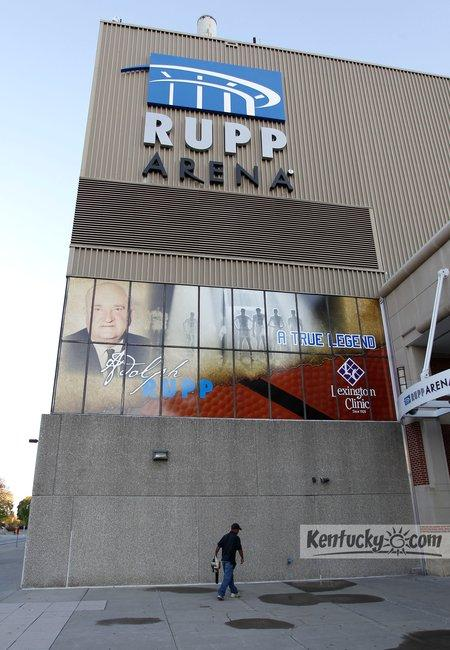 Rodney Grey, with the Lexington Center, cleaned the sidewalk under a banner honoring former UK basketball coach Adolph Rupp outside Rupp Arena on West High Street near South Broadway in Lexington, Ky., Friday, October, 14, 2011. Rupp Arena opened in 1976.