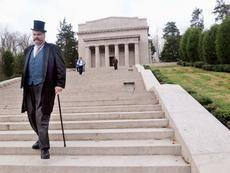 President William Howard Taft, portrayed by Dale Liikala of Mentor, Ohio, descends the steps of the Abraham Lincoln Memorial Hall on Monday during a centennial celebration of the opening of the building.