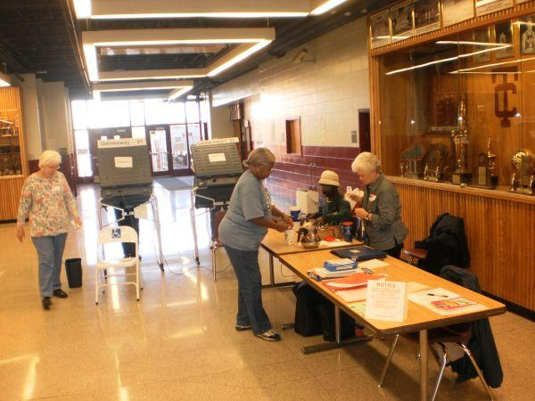 Polling Officials at Tates Creek High School in Lexington.
