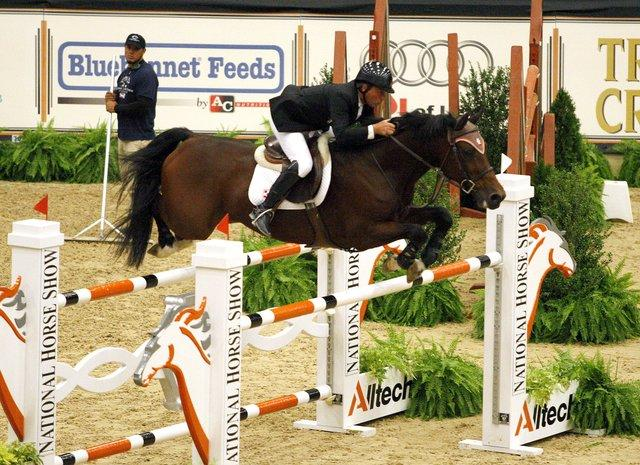 Todd Minikus and Sweetheart negotiated a fence during the Sasco Creek Farm International Open Jumpers $50,000 Welcome Stakes during the first day of competition at the Alltech National Horse Show at the Kentucky Horse Pa