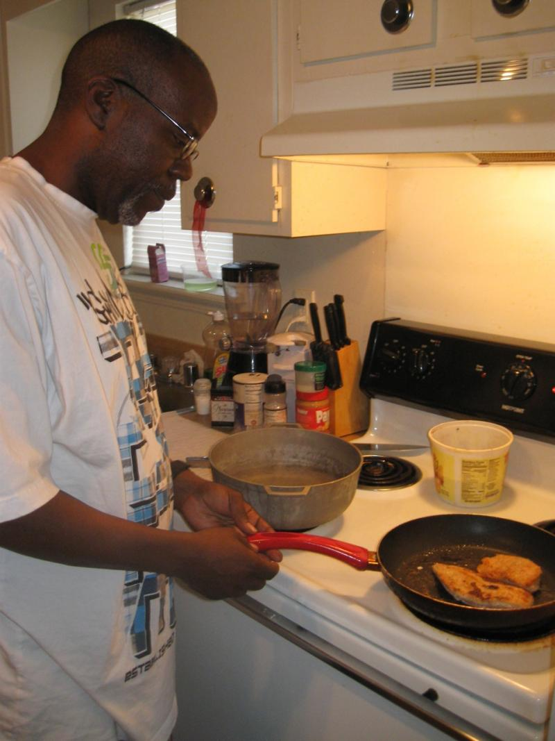 Sullivan University culinary student Jackson Hodges cooks chicken breasts in béchamel sauce.
