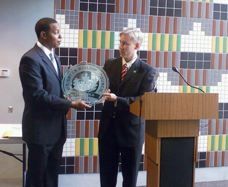 First District Councilman Chris Ford accepts LEED Gold certification plaque.
