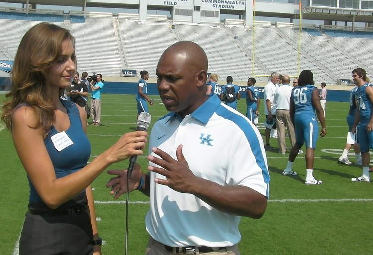 Maria Montgomery interviews University of Kentucky football coach Joker Phillips as part of her work for vaughtsviews.com