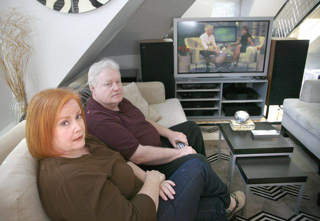 Susan and Bill Hardy of Lexington have the TV in their living room that is at the heart of a lawsuit brought by Dermot and Hilary Halpin, who said it was defective when they bought it from Bill Hardy's electronics store in 2002.