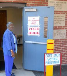Eleanor Guerrero prepares to enter the Fort Knox precinct at Stithton Baptist Church to cast her first vote as a U.S. citizen. The 72-year-old native of Belize became an American this summer after living 43 years in the country.