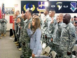 Twenty-one soldiers and their family members became U.S. citizens following a ceremony held Monday at 101st Airborne Division Headquarters.