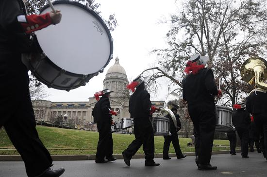 The Newport High School Marching Band passes the Capitol during the Inaugural Parade Tuesday morning.