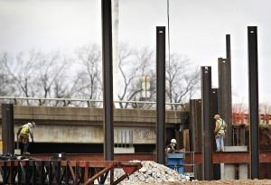 Construction crews continue to work on expanding the bridge at the I-65 Scottsville Road exit on Wednesday.