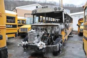 A burned-out Pike County school bus sits in the Pike County Schools transportation lot in Pikeville after catching fire early Thursday morning. School district officials believe the fire was intentionally set.