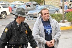 Kentucky State Police Trooper Michael Webb escorts Bobby Bowling, 26, of Elkhorn City, into the Pike County Detention Center following a drug roundup on Tuesday. Bowling and several others were arrested in the bust, which targeted 18 people.