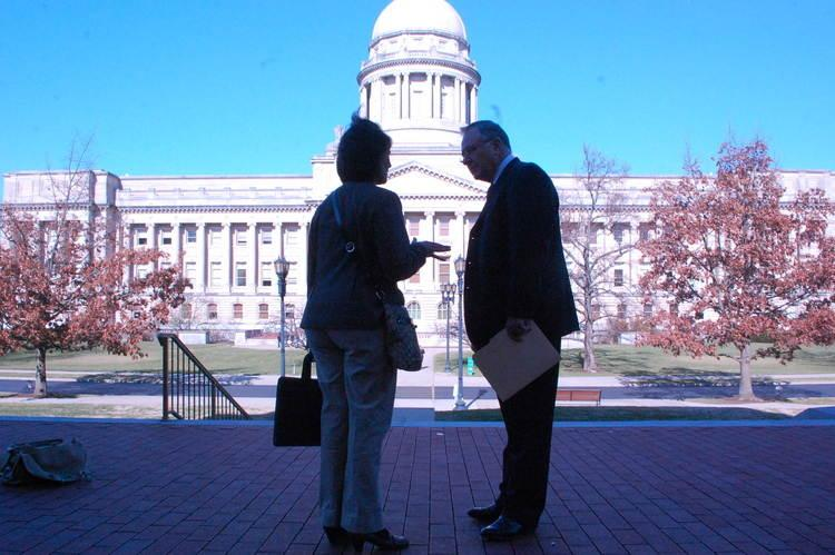 Rep. Danny Ford chats with lobbyist Paula Smith outside the Capitol last week.