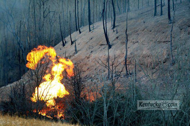 A large flame was still visible Tuesday morning after a gas line ruptured last night off Ky. 89 near Irvine. The buried gas line ruptured Monday night, creating a huge fire ball.
