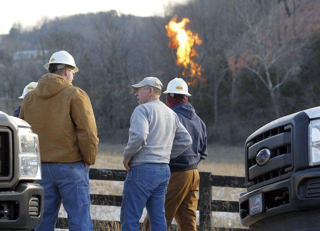 "Estill County resident H.D. Conrad, center, who said that ""as the crow flies, I live about 11/2 miles away"" from the scene of Monday night's gas pipeline explosion, talked to technicians from Columbia Gulf Transmission on Tuesday."