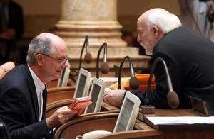 State Senators John Schickel (R-Union), left, and Jack Westwood (R-Erlanger) confer in the Senate chamber on the first day of the 2012 Kentucky General Assembly in Frankfort.