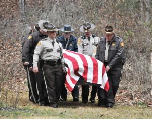Pike County Sheriff's deputies carry their colleague James I. Thacker to his final resting place during his funeral on Friday. Thacker was killed in a vehicle crash Monday night on U.S. 460.
