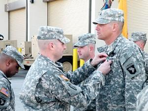 Sgt. Shaun Chandler (right), of Tallulah, La., received the Army Commendation Medal with Valor Device from Col. Valery Keaveny Jr. along with two other soldiers at a Fort Campbell ceremony on Monday. All three men earned the award for bravery under fire