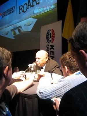 Bruton Smith, chairman of Speedway Motorsports Inc. and owner of Kentucky Speedway, talks to reporters Wednesday about improvements in traffic control and parking at the Kentucky track in anticipation of this year's NASCAR Sprint Cup weekend.