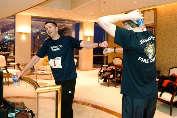 "Lexington police Officer James Boyd, left, and Lexington firefighter Zach Ferguson celebrated their finishes in the 29-flight climb on Saturday. ""I was seeing stars when I finished,"" said Boyd."