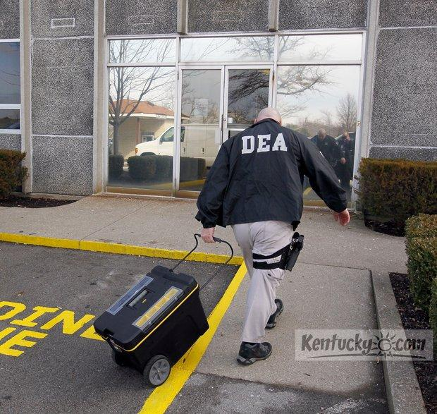 A DEA agent entered the building during a morning raid by DEA, State Police and Lexington Police at Lexington Algiatry, a pain clinic at 1718 Alexandria Drive in Lexington, Ky., Wednesday, February 15, 2012.