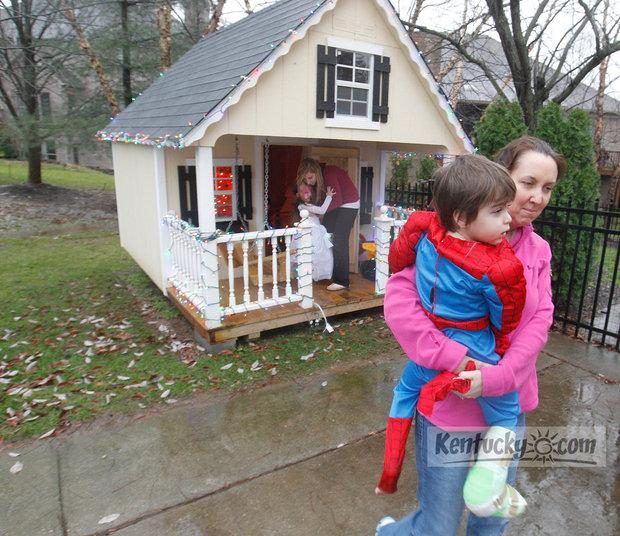 Cooper and his mother, Tiffiney Veloudis, walk back to the family home after playing in the playhouse (background) on Monday, Dec. 5, 2011. Cooper's sisters Ally, 4, and Jordan Wade, 22, are on the playhouse porch.