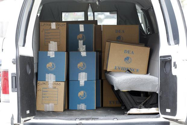 During Wednesday's raid at Lexington Algiatry, a pain clinic on Alexandria Drive, authorities collected boxes of evidence.