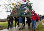 Mickey Inez, right, Thomas Madison, center, and Lisa Abbott carry the mountain's as they protest mountaintop removal Tuesday at the Capitol. The mountain, covered by pinwheels, was placed on the Governor's Mansion lawn.