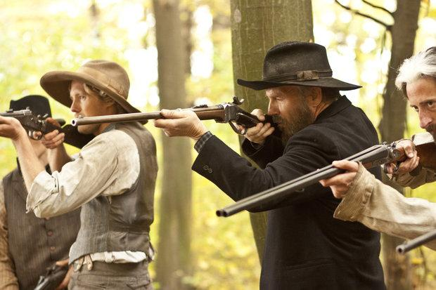 Kevin Costner, second from right, stars as Devil Anse Hatfield in Hatfields & McCoys. Bill Paxton portrays Randall McCoy. The miniseries was been a runaway ratings winner, cable or network.