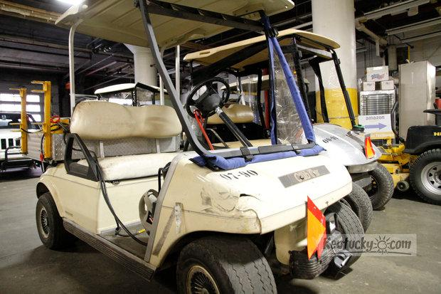 Damaged golf cart, with front right area cracked and headlights damaged, shown on Tuesday, June 5, 2012 in the basement of the UK Peterson Service Building.