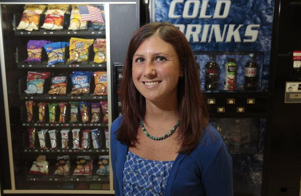 Melissa Smith, a registered dietitian with vending machines at Lexington-Fayette Co. Health Department, in Lexington, Ky., on June 13, 2012.