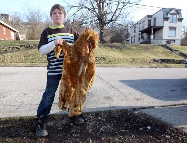 Andrew Fuller, 10, holds the lion costume he was wearing in 2009 when he was attacked by a neighbor's dog near his home on West 13th Street in Newport.
