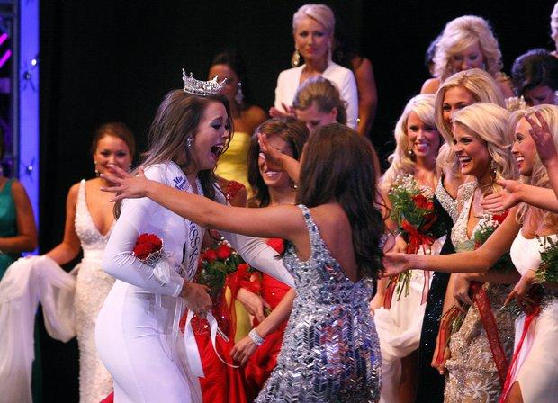 Jessica Casebolt, left, was congratulated by other contestants after being crowned 2012 Miss Kentucky during the pageant Saturday night. Casebolt, Miss Goldenrod, is a Georgetown College student from Pikeville,