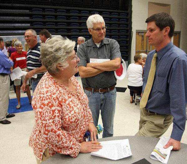 Jessamine County Transportation chairwoman Nancy Stone, left, and Jessamine County Magistrate Tim Vaughan, right, spoke with resident Walter Roycraft during Tuesday's workshop.