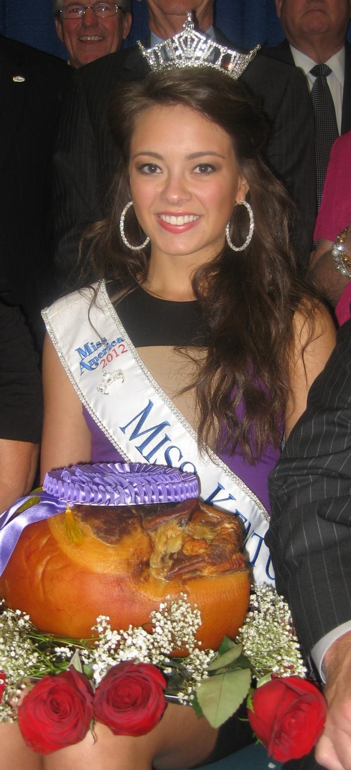 The grand champion country ham, displayed by Miss Kentucky Jessica Casebolt, was produced by Scott Hams of Greenville, Kentucky.