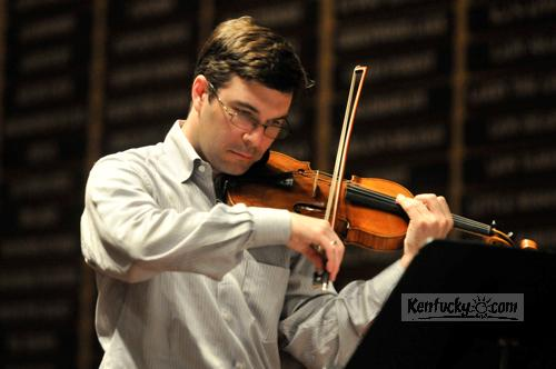 Nathan Cole, violinist and artistic director of the Chamber Music Festival of Lexington, practiced Tuesday afternoon at the Fasig-Tipton Sales Pavilion.