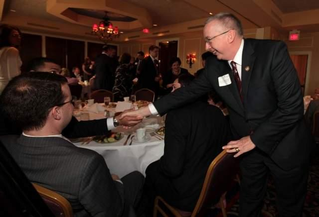 U.S. Rep. Geoff Davis greets people during a luncheon in March at the Metropolitan Club in Covington.