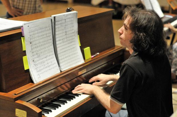 Bluegrass Opera music director and conductor Lorne Dechtenberg played at a rehearsal at Temple Adath Israel last week.
