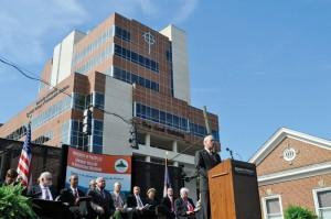 University of Pikeville President Paul Patton speaks at a ceremony on Saturday officially opening the school's newest facility, The Coal Building, which towers above in the background.