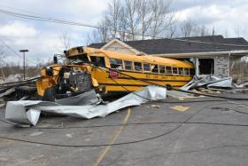 A bus thrown into a store in Henryville, IN after tornadoes ripped through the town on March 2, 2012.