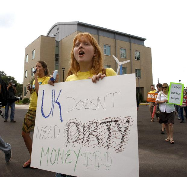 Samantha Meador chanted as she marched outside the Wildcat Coal Lodge during an anti-coal rally Wednesday.