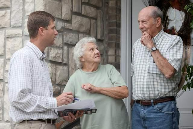 Brian Linder, Republican candidate for House District 61, talks with Hazel and Leo Webster of Crittenden while campaigning door-to-door along Maple Ridge last week.