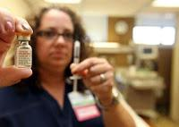 Ashel Kruetzkamp with a vial of Naloxone HCl, used to treat those who overdose on heroin. (Photo by Patrick Reddy)