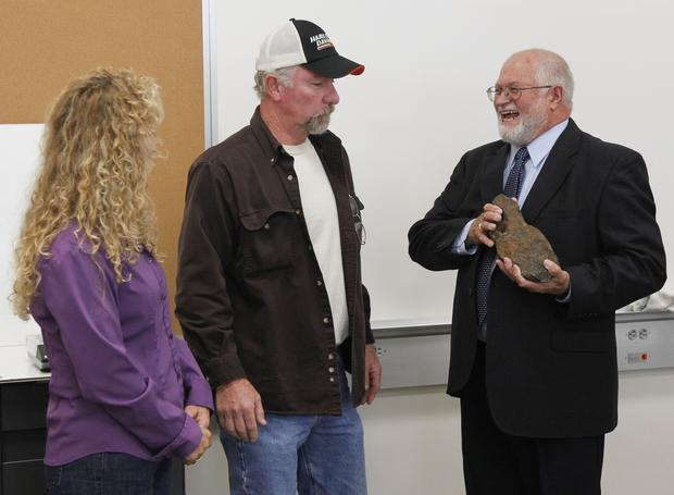 "George and Donna Lewis of Bell County presented the meteorite to Jerry Cook, chairman of EKU's Physics and Astronomy department. ""My precious,"" Cook gushed about the rock."