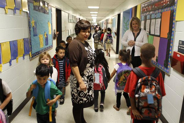 Principal Ivonne Beegle, left, and Administrative Dean Suzanne Ray, right, greeted arriving students at Cardinal Valley Elementary School, 218 Mandalay Rd. in Lexington, Ky., Wednesday, September, 22, 2010.
