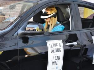 A University of Pikeville student participates in the virtual reality driving simulator, which shows various scenarios drivers can experience while texting and driving.