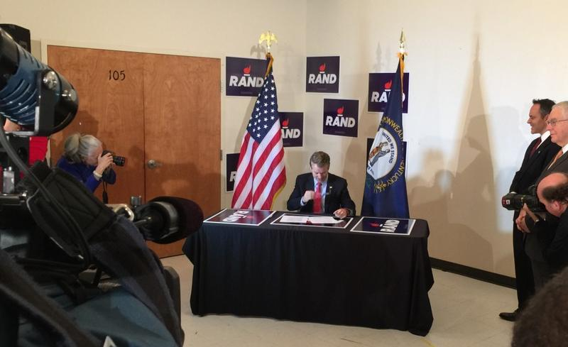 Sen. Rand Paul, R-Kentucky, signs candidate filings in Louisville for the Kentucky presidential caucus and re-election to the U.S. Senate.