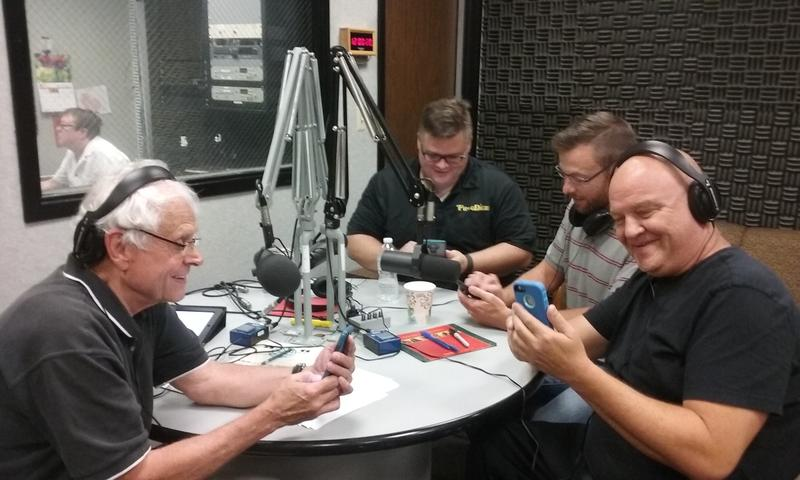 The guys checking their phones to see if any Pokemon are in the studio with them.