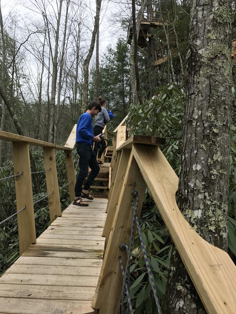 Climbing the steps to get to the Observatory treehouse