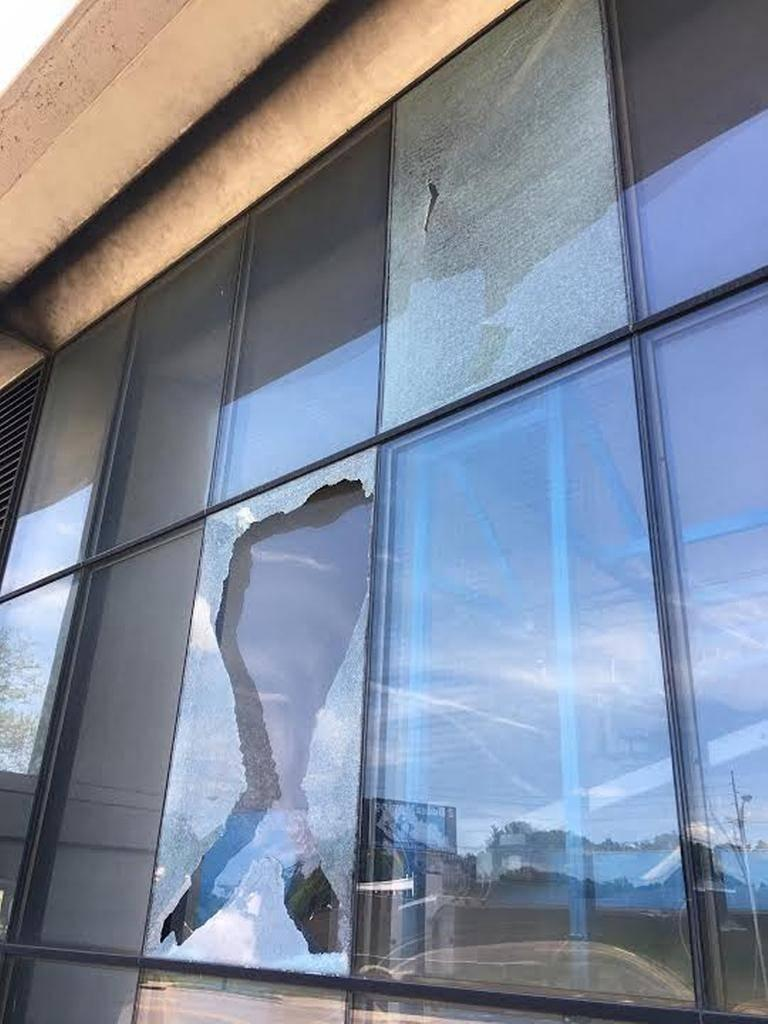 Two shattered windows on the Midland Avenue side of the Lexington Herald-Leader