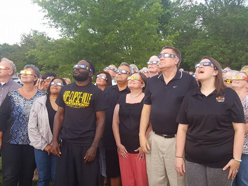Hopkinsville residents try out special eclipse viewing glasses.