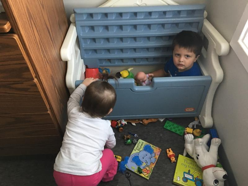 Christabelle checks out Kaiden who really gets into his toy box.